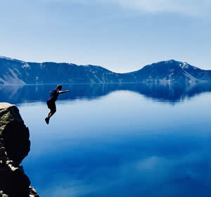 Tom Venable leaps into Crater Lake