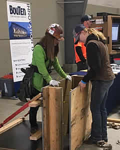 Female student explores construction career booth