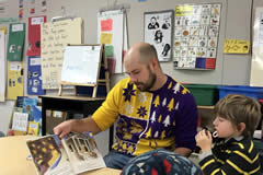 Max Thomas reading to students