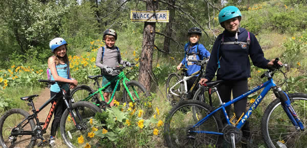 Students mountain biking at Sun Mountain