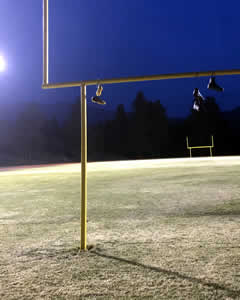 Shoes hanging over goal posts