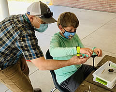 MVE student learns to tie flies from Jonathan Stratman