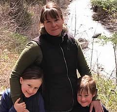 MVE Teacher Libby Foley and family near a river